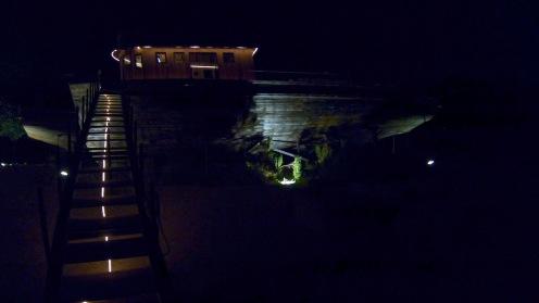The boat bar lit up at night